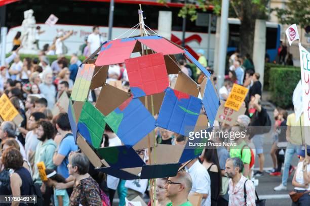 Demonstrators hold banners at the demonstration in Madrid organized by Fridays For Future Alianza por el Clima Alianza por la Emergencia Climática...