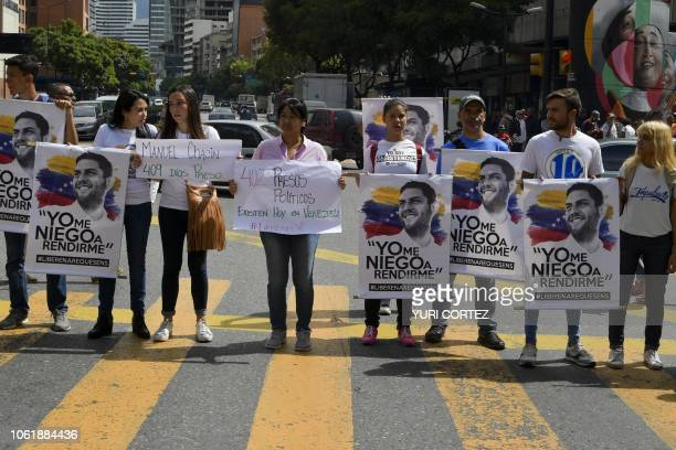 Demonstrators hold banners during a protest promoted by relatives and parents to demand the freedom of political prisoners in Caracas Venezuela on...