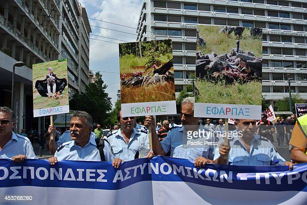Demonstrators hold banners that accuse politicians of being vultures that eat the money they have earned with difficulty Members of the Greek Public...
