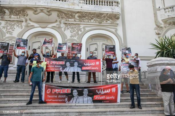 Demonstrators hold banners that read in english Free Yassine Ayari as others read in Arabic release Yassine Ayari, during a demonstration held in...