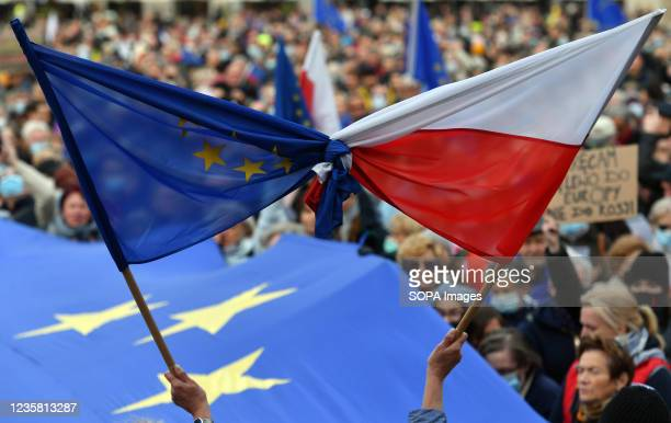 Demonstrators hold bound flags of the European Union and Poland during the demonstration. A Pro-European demonstration was held by opponents of the...