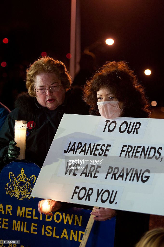 Demonstrators hold candles and signs at the 32nd annual vigil in remembrance of the disaster at the Three Mile Island Nuclear Plant March 28, 2011 in Middletown, Pennsylvania. The gathering to remember the accident, in which Unit #1's core melted down on March 28, 1979, is dedicated to the victims of the earthquake and tsunami in Japan.