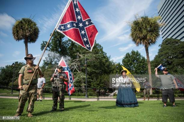 Demonstrators hold Confederate battle flags at the South Carolina Statehouse grounds July 10 2017 in Columbia South Carolina To mark the two year...