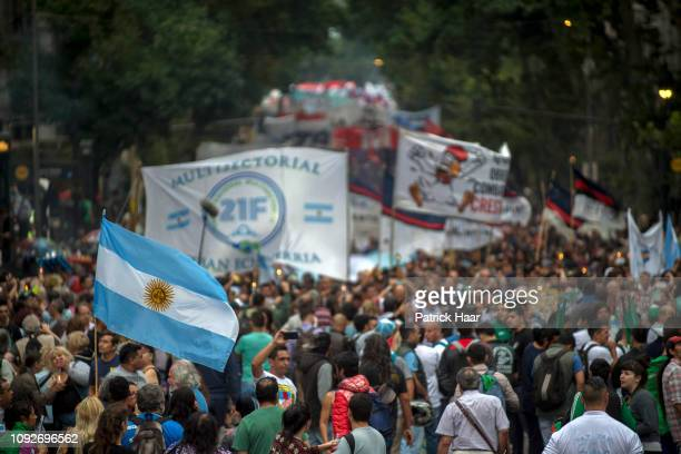 Demonstrators hold flags and banners during a demonstration against the increase in public service fees on January 10 2019 in Buenos Aires Argentina