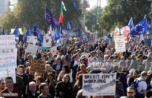 Demonstrators hold flags and placards as they march during the antiBrexit People's Vote march in London UK on Saturday Oct 20 2018 The march which...