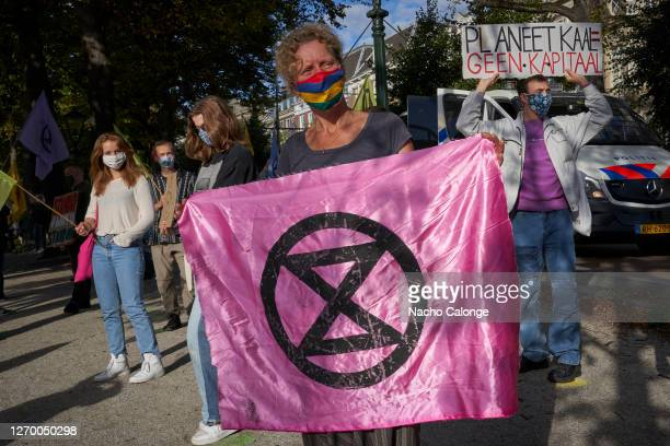 Demonstrators hold flags and placards referring to climate change during the demonstration in The Hague on September 1 2020 in The Hague Netherlands...