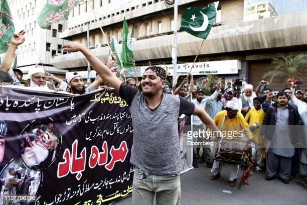 Demonstrators hold flags during an antiIndia protest in Karachi Pakistan on Wednesday Feb 27 2019 Pakistani fighter jets have shot down two Indian...