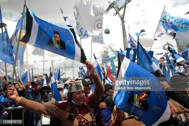 Demonstrators hold flags with the face of former president Evo Morales during a MAS closing rally ahead of Presidential elections on October 14, 2020...