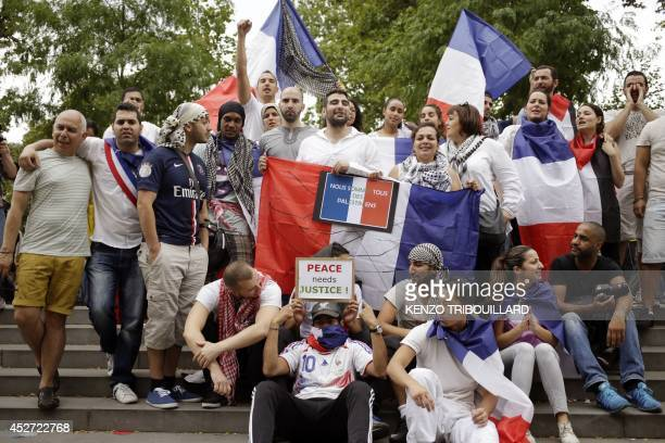 Demonstrators hold French flags on the Republique square in Paris during a banned demonstration against Israel's military operation in Gaza and in...