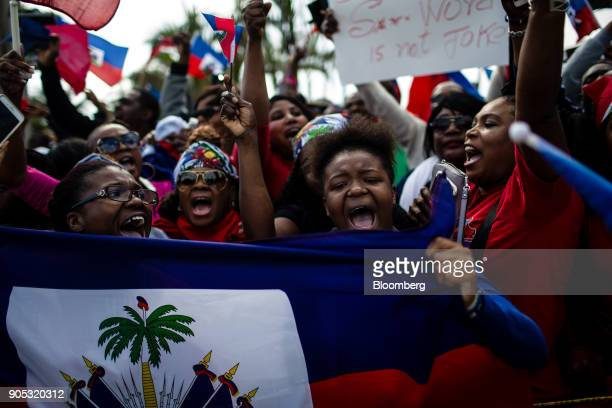 Demonstrators hold Haitian flags and chant during a protest against U.S. President Donald Trump near Mar-a-Lago in Palm Beach, Florida, U.S., on...