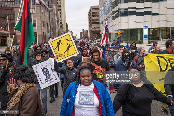 Demonstrators hold hands and march on St Clair Ave on December 29 2015 in downtown Cleveland Ohio Protestors took to the street the day after a grand...