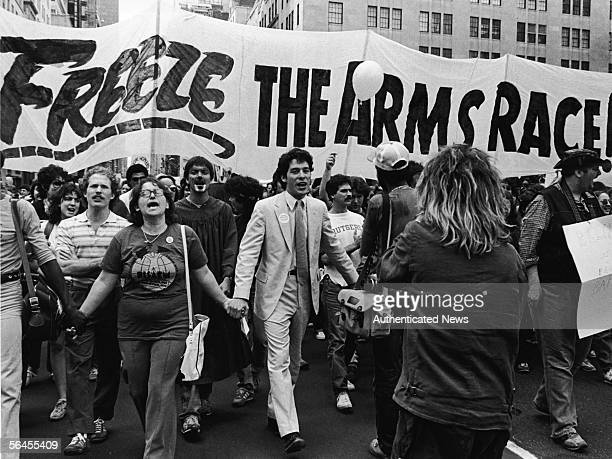 Demonstrators hold hands and vocalize as they march towards Central Park during a massive nuclear disarmament rally where 750,000 gathered to demand...