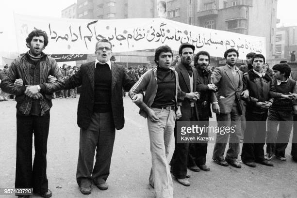Demonstrators hold hands while participating in the protests on Ashura Day in Shah Reza street during the Iranian Revolution on 11th December 1978 in...