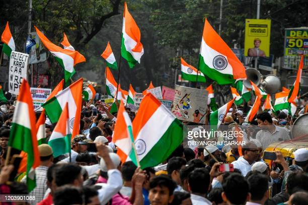 Demonstrators hold Indian national flags as they protest against India's new citizenship law during a demonstration in Kolkata on February 28 2020