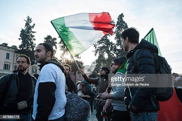 Demonstrators hold Italian flags as they take part in the protest of the Forconi Movement at Piazza del Popolo on December 18, 2013 in Rome, Italy....