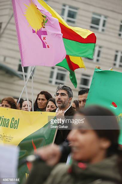 Demonstrators hold Kurdish flags at a rally by expatriateKurds who were protesting against the ongoing violence by militias of the Islamic State in...