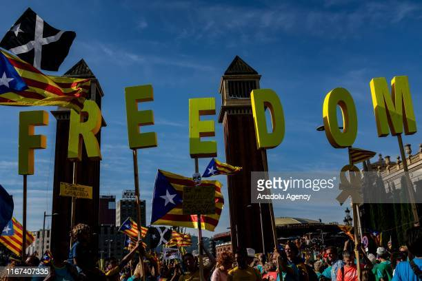 Demonstrators hold letters reading Freedom as they gather during Catalonia's national day known as Diada Nacional de Catalunya at Plaza Espana in...