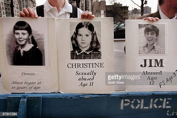 Demonstrators hold pictures of abuse victims outside Holy Name Cathedral April 14 2006 in Chicago Illinois The demonstrators are calling for Cardinal...