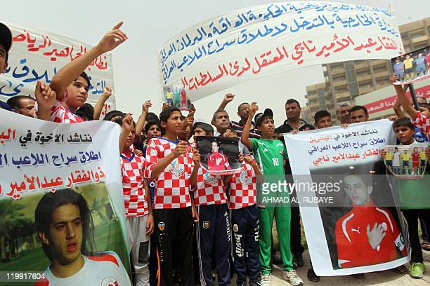 Demonstrators hold pictures of Iraqi footballer Zulfiqar Nagi during a demonstration in Baghdad on July 27 2011 Dozens of Iraqi athletes demanded...