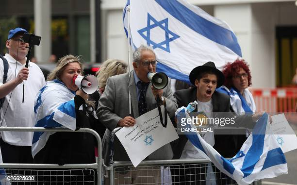 Demonstrators hold placards and flags of Israel as they protest outside the headquarters of Britain's opposition Labour party in central London on...