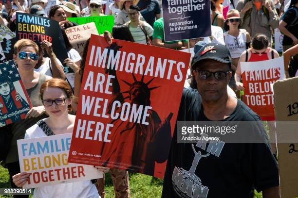 Demonstrators hold placards and march to protest US President Donald J Trump and his immigration policy concerning Muslims and Immigrants from Latin...