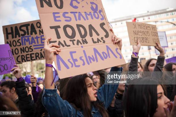 Demonstrators hold placards and shout slogans as they protest during a one day strike to defend women's rights on International Women's Day on March...