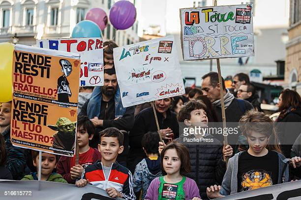 Demonstrators hold placards and shout slogans as they take part in a demonstration against evictions and cuts Thousands of people from the social...