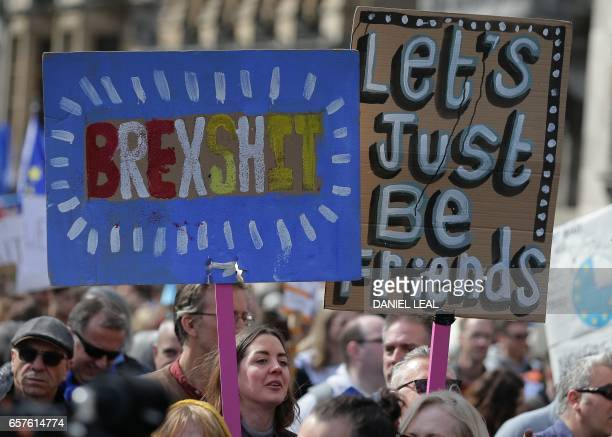 TOPSHOT Demonstrators hold placards and wave EU flags as they participate in an anti Brexit proEuropean Union march in London on March 25 ahead of...