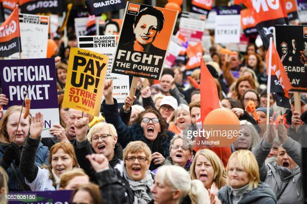 Demonstrators hold placards as they attend a rally in George Square following a march for equal pay for Glasgow council workers on October 23 2018 in...