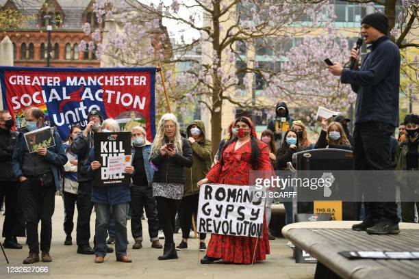 Demonstrators hold placards as they protest against the Police, Crime, Sentencing and Courts Bill 2021 in central Manchester on May 1, 2021. -...