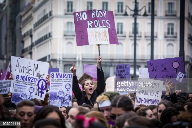 Demonstrators hold placards as they protest during a one day strike to defend women's rights on International Women's Day in Madrid on March 8 2018...