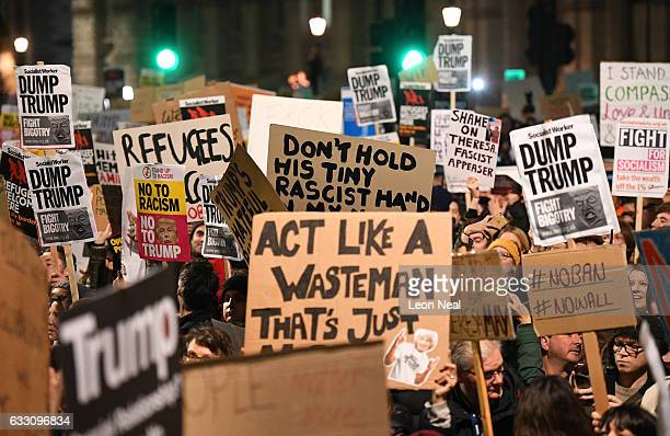 Demonstrators hold placards as they protest outside Downing Street on January 30 2017 in London England President Trump signed an executive order on...