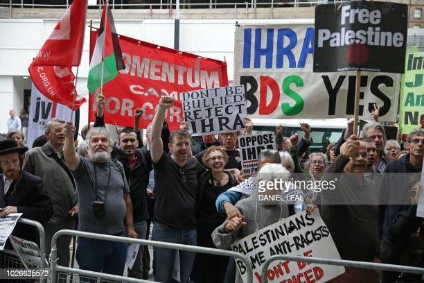 Demonstrators hold placards as they protest outside the headquarters of Britain's opposition Labour party in central London on September 4 2018...