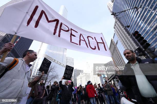 Demonstrators hold placards as they stage a Presidents Day protest near Trump Tower on February 20 2017 in Chicago Illinois The demonstration was one...