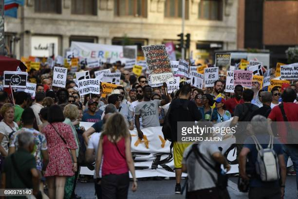 Demonstrators hold placards during a prorefugees demonstration called by more than one hundred organizations to demand the Spanish government 'No...