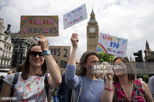 Demonstrators hold placards duringa protest against the proBrexit outcome of the UK's June 23 referendum on the European Union in central London on...