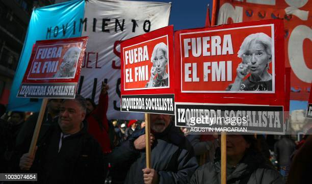 Demonstrators hold placards reading 'IMF Out' during a protest against Argentina's latest agreement with the International Monetary Fund in Buenos...