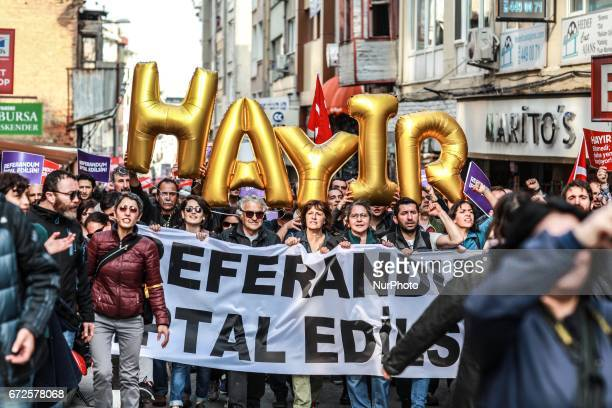 Demonstrators hold placards reading quotReferendum should be cancelledquot during a protest at the Kadikoy district in Istanbul on April 23 2017...