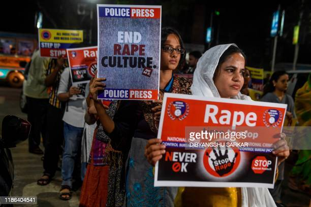 Demonstrators hold placards to protest against sexual assaults on women, following the alleged gang-rape and murder of a 27-year-old veterinarian in...
