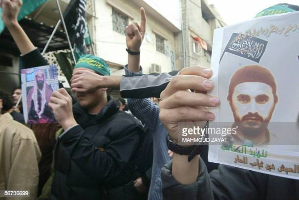 Demonstrators hold portraits of Jordanian Islamist Abu Musab alZarqawi and alQaeda leader Osama bin Laden as they protest against the publication of...