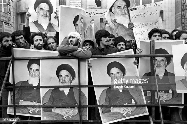 Demonstrators hold posters of Ayatollah Khomeini outside the American Embassy which is occupied by 'students following the Imam Khomeini's line' on...