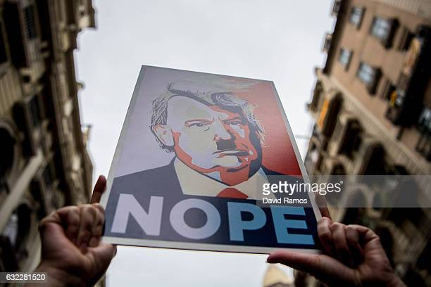 Demonstrators hold posters of Donald Trump as they make their way during the Women's March on January 21 2017 in Barcelona Spain The Women's March...