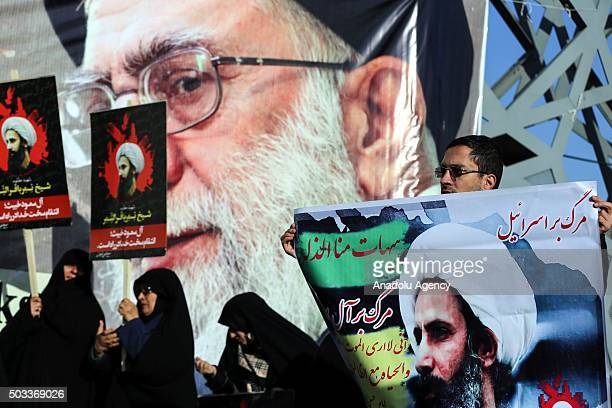 Demonstrators hold posters of Nimr Baqir alNimr during a protest rally against the execution of prominent Saudi Shia cleric Nimr Baqir alNimr by...