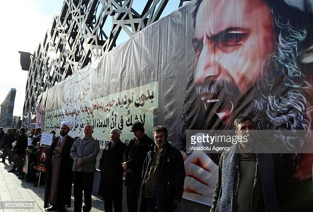 Demonstrators hold posters of Nimr Baqir al-Nimr during a protest rally against the execution of prominent Saudi Shia cleric Nimr Baqir al-Nimr by...