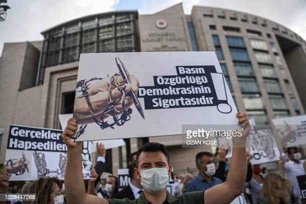 """Demonstrators hold posters reading """" Journalism is the insurance of democracy"""" """"If the journalist is arrested, you won't know about news"""" as they..."""