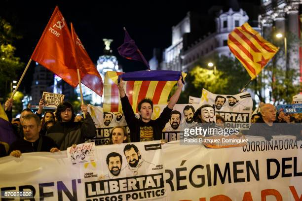 Demonstrators hold proindependence Catalan flags and placards reading 'freedom for political prisoners' showing pictures of imprisoned leader of the...