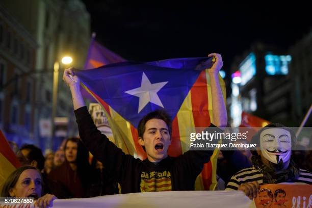 Demonstrators hold proindependence Catalan flags and shout slogans during a protest at Alcala Street on November 5 2017 in Madrid Spain Organizers...
