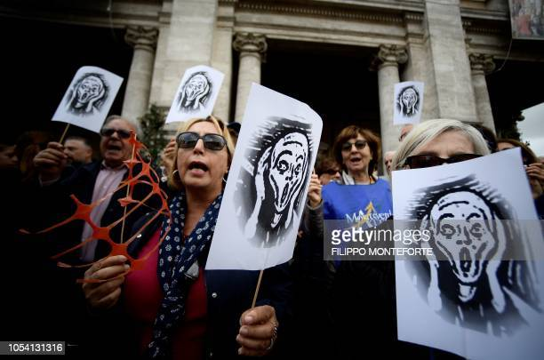 TOPSHOT Demonstrators hold reproduction of Norwegian Expressionist artist Edvard Munch's painting the Shout in Rome 's Piazza del Campidoglio on...