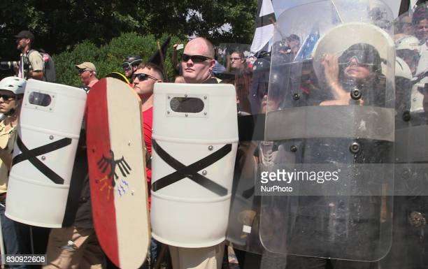 Demonstrators hold shields during the Unite the Right free speech rally at Emancipation Park in Charlottesville Virginia USA on August 12 2017