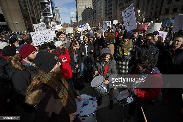 Demonstrators hold signs and beat drums outside of the US Consulate General during a protest in Toronto Ontario Canada on Monday Jan 30 2017 Canada's...